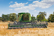John Deere 9610 combine harvester after cutting the last of the wheat crops as the harvest season comes to an end near Toogong, New South Wales, Australia