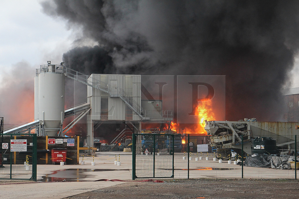"© Licensed to London News Pictures . 15/03/2015 . Salford , UK . Roads are closed and people have been evacuated as a large fire burns at a unit within "" Junction Eco-Park "" in Clifton , Greater Manchester , this evening (Sunday 15th March 2015) . The smoke and flames can be seen for many miles . Forty fire fighters are at the scene working to control the blaze . Photo credit : LNP"