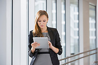 Businesswoman using tablet PC in office
