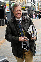© Licensed to London News Pictures. 28/04/2019. London, UK. Brexit Party leader NIGEL FARAGE is seen leaving the studio of LBC radio in central London following interview. The Brexit Party has seen a surge in support following it's recent launch ahead of European Elections in May . Photo credit: Ben Cawthra/LNP
