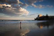 A Swimmer leaves the water at sunset at South Cronulla Beach.