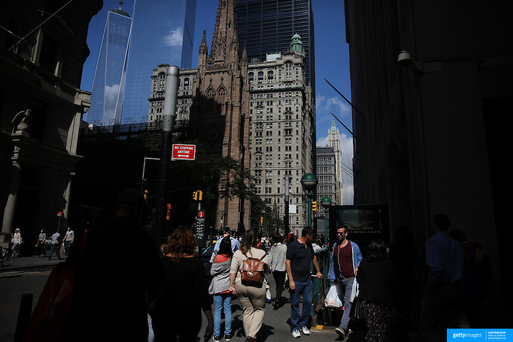 A street scene in Downtown Manhattan showing The One World Trade Center in New York City, USA. 16th September 2014. Photo Tim Clayton