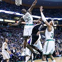 30 January 2013: Sacramento Kings point guard Tyreke Evans (13) goes for the layup against Boston Celtics power forward Brandon Bass (30) and Boston Celtics small forward Paul Pierce (34) during the Boston Celtics 99-81 victory over the Sacramento Kings at the TD Garden, Boston, Massachusetts, USA.