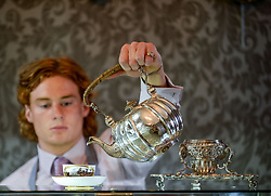 Bonham's staff member Harry Devlin with a rare silver tea kettle dated 1733 which is coming under the hammer in Edinburgh 14 June.<br /> <br /> © Dave Johnston/ EEm