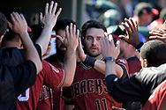 SURPRISE, AZ - MARCH 06:  A.J. Pollock #11 of the Arizona Diamondbacks is congratulate by teammates after scoring against the Kansas City Royals during the fourth ining of the spring training game at Surprise Stadium on March 6, 2017 in Surprise, Arizona.  (Photo by Jennifer Stewart/Getty Images)