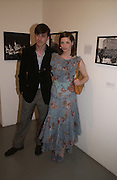 Enzo Chiventi and Sienna Guillory, The Shape of Things, first night party. Photographers Gallery, 17 May 2004. ONE TIME USE ONLY - DO NOT ARCHIVE  © Copyright Photograph by Dafydd Jones 66 Stockwell Park Rd. London SW9 0DA Tel 020 7733 0108 www.dafjones.com