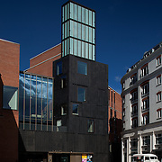 Building Name: MAC, BELFAST<br /> Building Type: CULTURE AND ENTERTAINMENT - CULTURAL CENTRE<br /> Architect: HALL MCKNIGHT<br /> Architect Website: http://www.hallmcknight.com<br /> Clients Website: http://themaclive.com<br /> Town:BELFAST<br /> Year of Completion: 2012<br /> County:ANTRIM<br /> Collection: Architecture<br /> Country: United Kingdom<br /> <br /> The building was completed by Hackett Hall McKnight in February 2012 and provides performance spaces, art galleries and supporting facilities. A new public space for the city has been provided in the foyers which recall the tight streetscape of the neighbourhood &ndash; a compressed urban environment characterised by top&ndash;light. The approach to material and construction evokes a relationship to the robust character of the preceding Victorian merchant city; large scale tough brick buildings. The construction uses the structural insitu concrete as well as the brick as an exposed finish.
