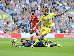 Sheffield Wednesday's Stevie May bests keeper Cardiff City's David Marshall but Cardiff City's Fabio Da Silva saves it off the goal line.  - Photo mandatory by-line: Alex James/JMP - Mobile: 07966 386802 - 27/09/2014 - SPORT - Football - Cardiff - Cardiff City Stadium - Cardiff City v Sheffield Wednesday - Sky Bet Championship