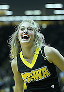 January 07, 2011: An Iowa Hawkeyes cheerleader during the the NCAA basketball game between the Ohio State Buckeyes and the Iowa Hawkeyes at Carver-Hawkeye Arena in Iowa City, Iowa on Saturday, January 7, 2012.