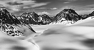 Aerial view of snow and icefield feeding Eagle Glacier in Chugach State Park in Southcentral Alaska. Spring. Afternoon.
