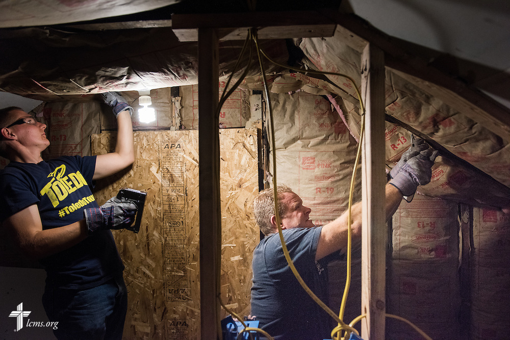 The Rev. Peter M. Burfeind, new domestic missionary and campus pastor at the University of Toledo, works with student Gunther Ruck (left) as they rehab a home as part of their Engineers in Christ project work on Thursday, July 9, 2015, in Toledo, Ohio. LCMS Communications/Erik M. Lunsford