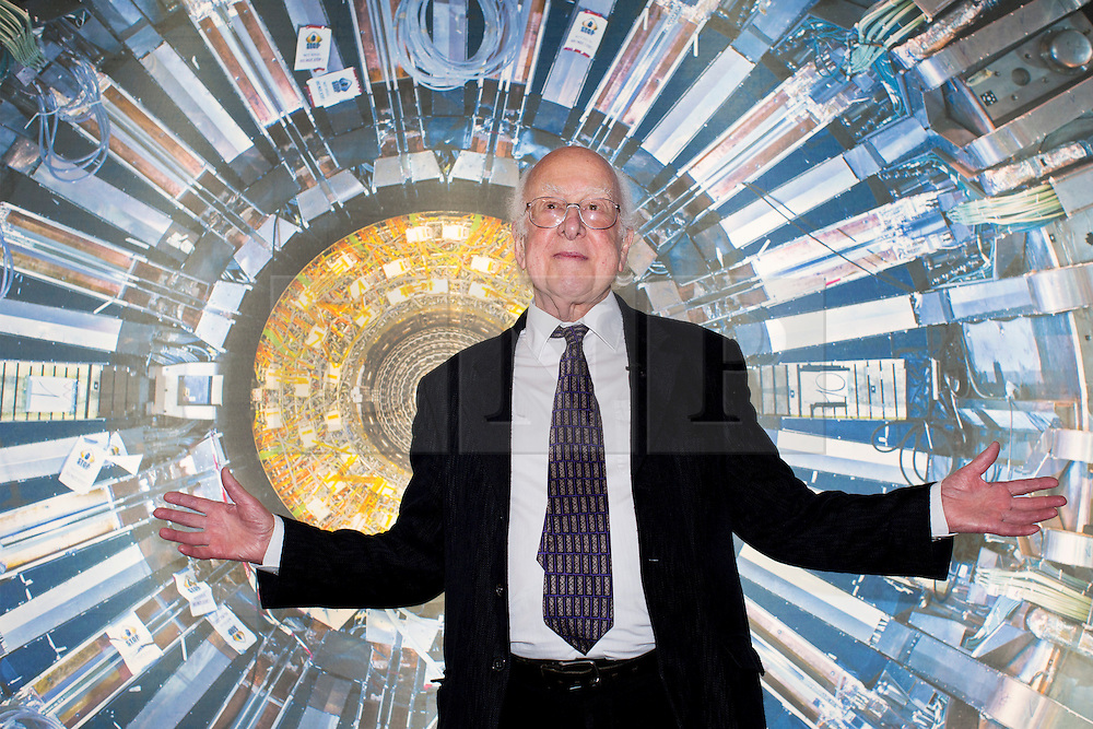 © licensed to London News Pictures. London, UK 12/11/2013. New Nobel laureate Peter Higgs attending the opening of the Collider exhibition at Science Museum in London. Collider exhibition offers a behind the scenes look at the CERN particle physics laboratory in Geneva and touches on the discovery of the 'God particle' theory of Peter Higgs. Photo credit: Tolga Akmen/LNP