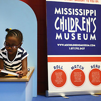 Adam Robison | BUY AT PHOTOS.DJOURNAL.COM<br /> Malyiah Thomas, a pre-k student at ECEC. reads a book in the interactive exhibit during class Thursday morning in Tupelo.