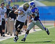 Oct 11, 2008; Lawrence, KS, USA; Colorado Buffaloes quarterback Cody Hawkins (7) rushes for a first down past  Kansas Jayhawks safety Darrell Stuckey (25) during the first quarter at Memorial Stadium.  Kansas won 30-14.