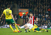 Norwich City's Timm Klose and Sheffield United's Chris Basham during the EFL Sky Bet Championship match between Norwich City and Sheffield Utd at Carrow Road, Norwich, England on 20 January 2018. Photo by John Marsh.