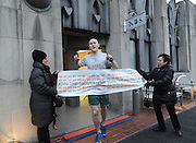 "Tim Oakes, of New York, the first male finisher, celebrates as he completes the New York City - Southern New York Chapter of the National Multiple Sclerosis Society's ""Climb to the Top,"" at Top of the Rock, Sunday, March 1, 2015, in New York.  (Photo by Diane Bondareff/Invision for Tishman Speyer/AP Images)"