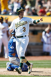 OAKLAND, CA - APRIL 17:  Chris Coghlan #3 of the Oakland Athletics celebrates after scoring a run against the Kansas City Royals during the seventh inning at the Oakland Coliseum on April 17, 2016 in Oakland, California.  The Oakland Athletics defeated the Kansas City Royals 3-2. (Photo by Jason O. Watson/Getty Images) *** Local Caption *** Chris Coghlan