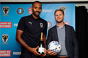 AFC Wimbledon midfielder Liam Trotter (14), Sponsor during the EFL Sky Bet League 1 match between AFC Wimbledon and Scunthorpe United at the Cherry Red Records Stadium, Kingston, England on 15 September 2018.