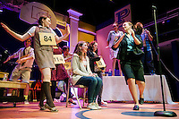 Meredith Ellis (Marcy Park) Kayla Zarella (seated), Claire Gardner (Vice Principal Dolores Panch give Zarella a send off during Winnipesaukee Playhouse dress rehearsal for the 25th annual Putnam County Spelling Bee on Thursday evening.  (Karen Bobotas/for the Laconia Daily Sun)