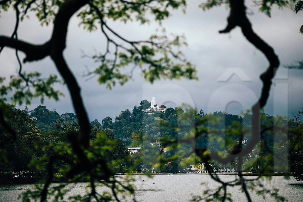 A view over Bogambara Lake to the giant Buddha statue, Kandy, Sri Lanka, Asia