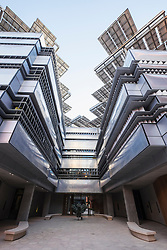 Modern architecture with solar panels on roof at Institute of Science and Technology at Masdar City in Abu Dhabi United Arab Emirates