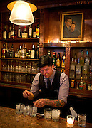 Bartender Joseph Buenrostro prepares drinks at the Kennedy Room  on Friday, January 18, 2013 in Dallas, Tx. (Cooper Neill/The Dallas Morning News)