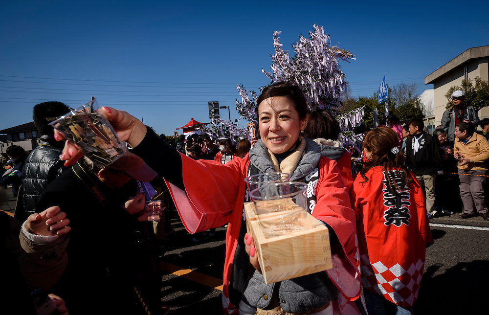 A woman serves snacks and sake to festival-goers during Honen-sai, a fertility festival at Tagata Shrine in Komaki, Aichi Prefecture, Japan. The traditional Shinto festival celebrates fertility and a bountiful harvest. The principal offering during the festival is a large wooden phallus. Each year a craftsman carves a new phallus from a Japanese cypress tree. It measures almost 2.4 meters (13 feet) long and weights 280kg (620 pounds).