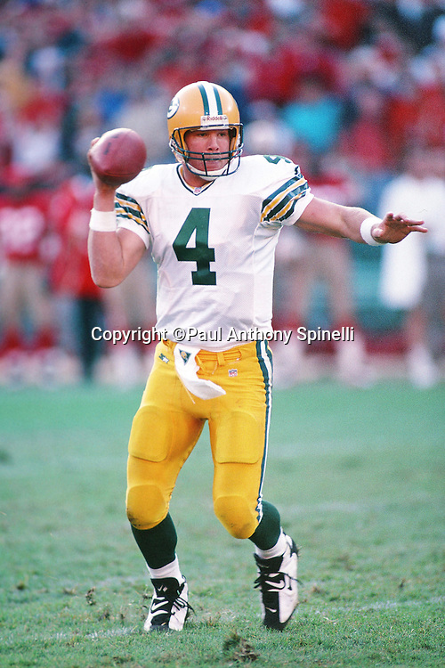 Green Bay Packers quarterback Brett Favre (4) pump fakes as he runs the ball during the NFL NFC Divisional Playoff football game against the San Francisco 49ers on Jan. 6, 1996 in San Francisco. The Packers won the game 27-17. (©Paul Anthony Spinelli)