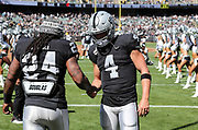 Sep 30, 2018; Oakland, CA, USA;  Oakland quarterback Derek Carr (4) and running back Marshawn Lynch (24) shake hands before taking the field for a game between the Oakland Raiders and the Cleveland Browns. The Raiders defeated the Browns 45-42 in overtime. Mandatory Credit: Spencer Allen-Image of Sport