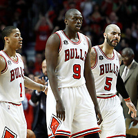 18 May 2011: Chicago Bulls point guard Derrick Rose (1), Chicago Bulls small forward Luol Deng (9) and Chicago Bulls power forward Carlos Boozer (5) are seen during the Miami Heat 85-75 victory over the Chicago Bulls, during game 2 of the Eastern Conference finals at the United Center, Chicago, Illinois, USA.