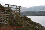 A gate and fence on the banks of Ullswater in the English Lake District.