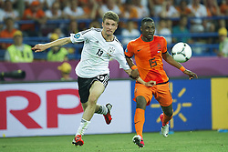 13-06-2012 VOETBAL: UEFA EURO 2012 DAY 6: POLEN OEKRAINE<br /> Mueller (GER #13 Bayern) Jetro Willems (NED #15) during the UEFA EURO 2012 group B match between Netherlands en Germany at Metalist Stadium, Charkov, UKR<br /> ***NETHERLANDS ONLY***<br /> ©2012-FotoHoogendoorn.nl