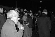 The 6 december 2006 a terrible crime took place in Erba, a mid-sized town between Como and Lecco in northern Italy. A young woman, her mother, and her two-year-old son were murdered in their apartment, along with a neighbor whose husband was also left for dead with his throat slashed, but survived after being pulled from the apartment, which had been set afire in an attempt to destroy the evidence.<br /> Suspicion first fell on the young woman's Tunisian husband, who had just been released from a minor jail sentence drug-related, but it quickly became clear that he had a cast-iron alibi: he was in Tunisia.<br /> The survivor was finally in condition to speak and provide information leading to the arrest of the downstairs neighbors, who eventually collapsed under interrogation and admitted to the premeditated massacre. The two families had been quarrelling for years over the noisiness of the murdered family; loud quarrels between the Tunisian husband and his Italian wife and the child crying. <br /> The Italian media has been obsessed with the crime and people were lined up from dawn to view the trial in Como's court. <br /> Olindo Romano and Rosa Bazzi, the neighbors, were found guilty of multiple murder by two sets of criminal proceedings.