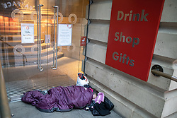 © Licensed to London News Pictures . 25/12/2018 . Manchester , UK . A homeless person sleeping rough outside the Royal Exchange Theatre in St Ann's Square in Manchester City Centre on Christmas Day . Photo credit : Joel Goodman/LNP