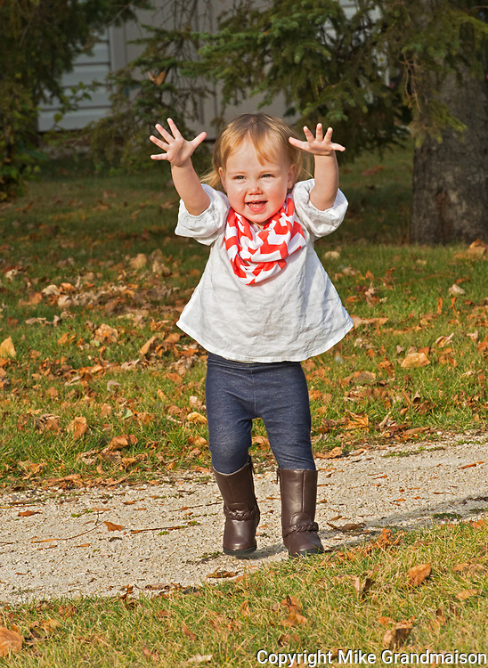 Young  girl playing in backyard<br />Winnipeg<br />Manitoba<br />Canada