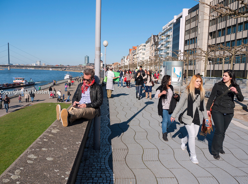 Promenade busy beside the River Rhine in Dusseldorf Germany