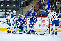 PENTICTON, CANADA - SEPTEMBER 16: Guillaume Brisebois #54 and Thatcher Demko #35 of Vancouver Canucks look for the pass to Collin Shirley #57 of Edmonton Oilers on September 16, 2016 at the South Okanagan Event Centre in Penticton, British Columbia, Canada.  (Photo by Marissa Baecker/Shoot the Breeze)  *** Local Caption *** Thatcher Demko; Guillaume Brisebois; Collin Shirley;