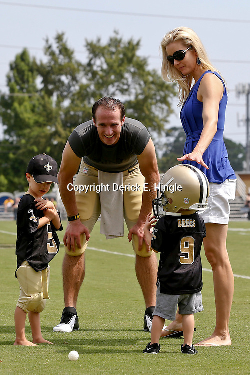 Aug 3, 2013; Metairie, LA, USA; New Orleans Saints quarterback Drew Brees (9) and wife Brittany Brees hold their son Bowen Brees following a scrimmage at the team training facility. Mandatory Credit: Derick E. Hingle-USA TODAY Sports