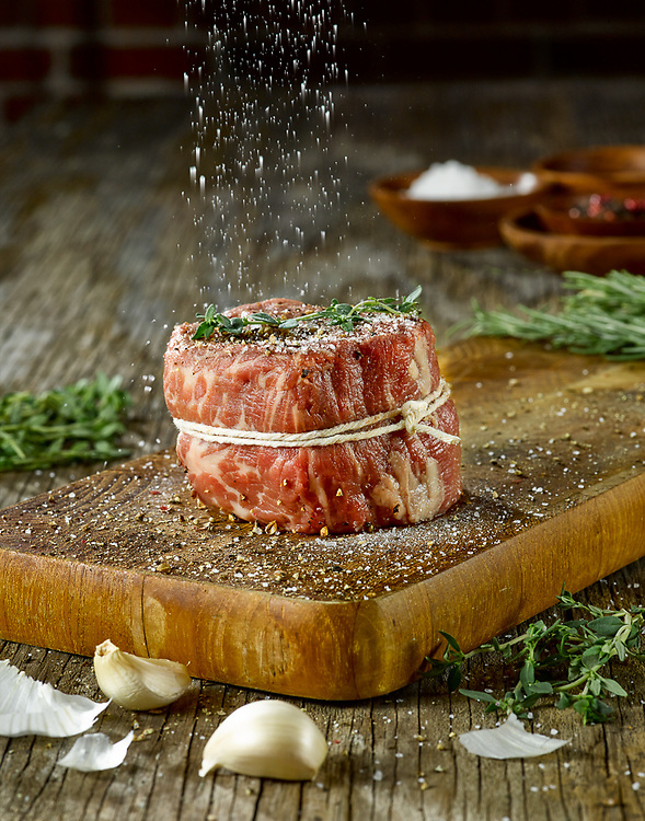 Salting a filet mignon by St. Louis Food Photographer Jonathan Gayman for The Insatiable Lens.