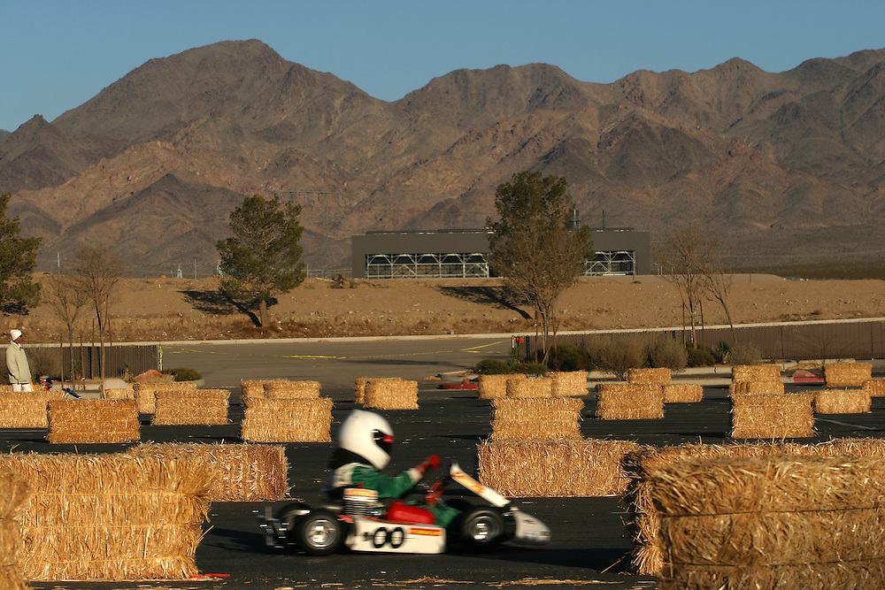 Young drivers whizz by in their go karts at the International Karting Federation race in Primm, Nevada on Saturday, March 3, 2007.