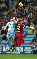 Photo: Ed Godden.<br />Coventry City v Brighton & Hove Albion. Coca Cola Championship. 04/02/2006. <br />Coventry's Michael Doyle (L) and Richard Carpenter,  challenge for the ball in mid-air.