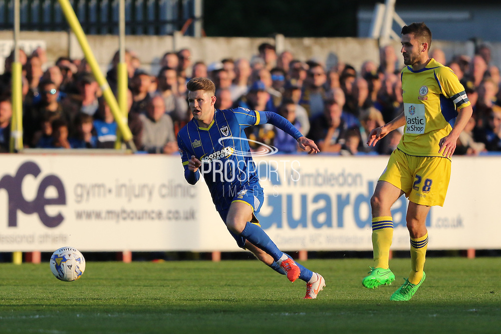 Jake Reeves midfielder for AFC Wimbledon (8) makes a break during  the Sky Bet League 2 Play-Off first leg match between AFC Wimbledon and Accrington Stanley at the Cherry Red Records Stadium, Kingston, England on 14 May 2016. Photo by Stuart Butcher.
