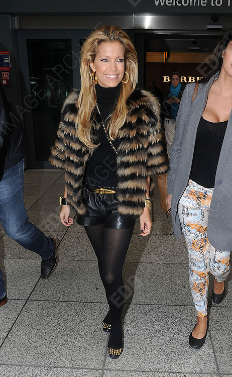 07.NOVEMBER.2012. LONDON<br /> <br /> SYLVIE VAN DER VAART WIFE OF DUTCH FOOTBALLER RAFAEL VAN DER VAART ARRIVING AT HEATHROW TERMINAL 5.<br /> <br /> BYLINE: EDBIMAGEARCHIVE.CO.UK<br /> <br /> *THIS IMAGE IS STRICTLY FOR UK NEWSPAPERS AND MAGAZINES ONLY*<br /> *FOR WORLD WIDE SALES AND WEB USE PLEASE CONTACT EDBIMAGEARCHIVE - 0208 954 5968*
