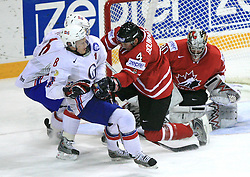 Mads Hansen (8) of Norway, Jay Bouwmeester (4) and Goalkeeper Cam Ward of Canada at play-off round quarterfinals ice-hockey game Norway vs Canada at IIHF WC 2008 in Halifax,  on May 14, 2008 in Metro Center, Halifax, Nova Scotia,Canada. (Photo by Vid Ponikvar / Sportal Images)