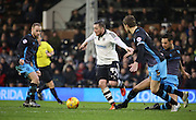Fulham Striker and captain Ross McCormack trying to find a way through during the Sky Bet Championship match between Fulham and Sheffield Wednesday at Craven Cottage, London, England on 2 January 2016. Photo by Matthew Redman.