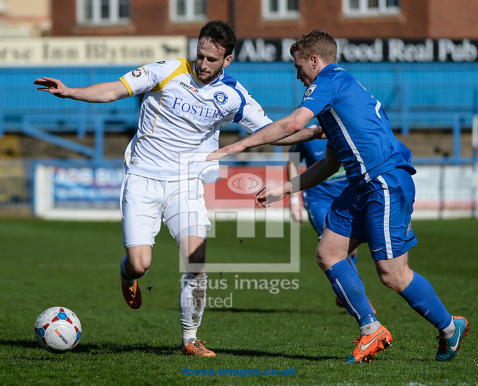 Jamie Yates of Gainsborough Trinity FC and Andrew Fisk of Lowestoft Town during the National League North match at the Northolme, Gainsborough<br /> Picture by Richard Land/Focus Images Ltd +44 7713 507003<br /> 16/04/2016