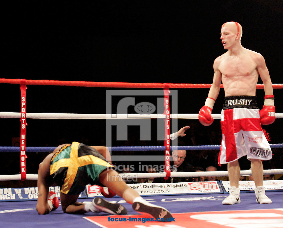 London - Saturday, February 2nd, 2008:  Michael  Walshknocks his opponent to the canves during his professional boxing debut against Delroy Spencer at The ExCel Centre London. .Walsh is one of three well-known Norfolk boxing brothers, who turned professional earlier this year, and all three are facing serious assault charges..Twins Liam and Ryan Walsh, 22, and elder brother Michael, 24, from Cromer will appear at the town's magistrates court on November 27 to answer allegations of causing grievous bodily harm..(Pic by Mark Chapman/Focus Images)
