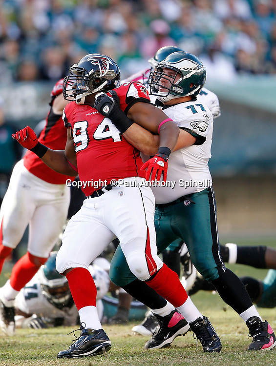 Atlanta Falcons defensive tackle Peria Jerry (94) gets blocked (and held) by Philadelphia Eagles guard Mike McGlynn (77) during the NFL week 6 football game against the Philadelphia Eagles on Sunday, October 17, 2010 in Philadelphia, Pennsylvania. The Eagles won the game 31-17. (©Paul Anthony Spinelli)