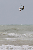 Chris Burns along with other Kitesurfers and surfers enjoying the 24mph gusty southwesterly winds during the afternoon of Tuesday 28 July 2015 at Tide Mills in Seaford, East Suusex on the south coast of England, UK