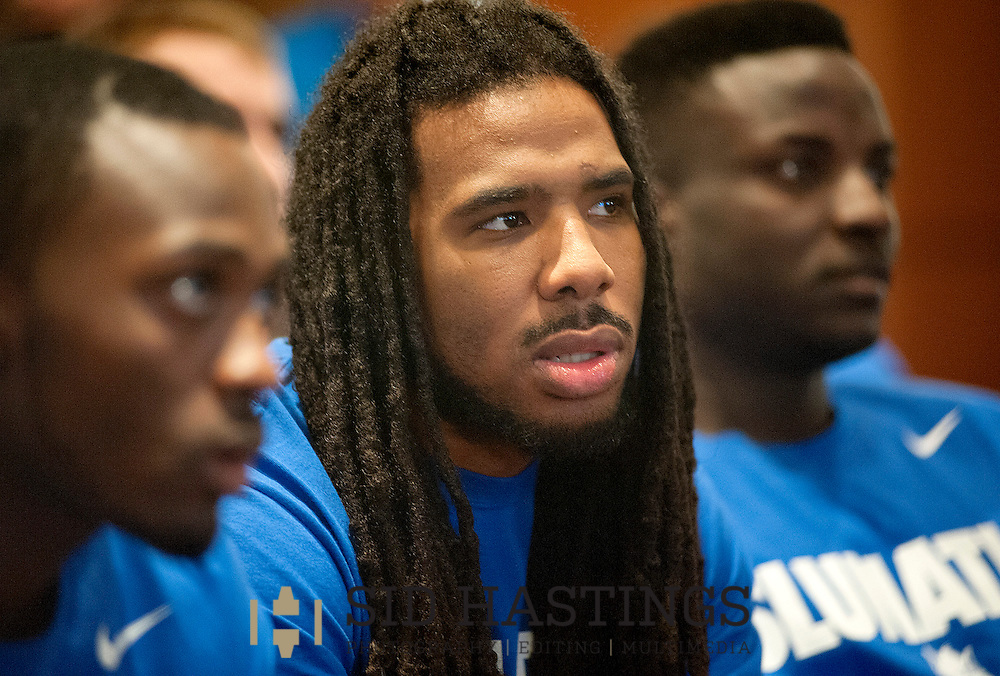 16 MARCH 2014 -- ST. LOUIS -- St. Louis University basketball players Mike McCall (left), Jordair Jett and  Reggie Agbeko watch as other teams are placed in the NCAA men's basketball tournament during an announcement party at Lorenzini's in Chaifetz Arena in St. Louis Sunday, March 16, 2014. Photo © 2014 Sid Hastings.